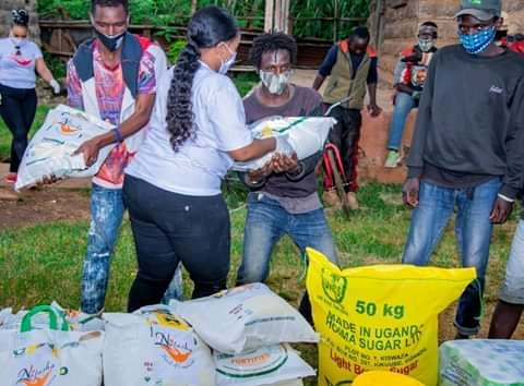 Rev Natasha puts Smiles To street Families with 3 month Food supply 1